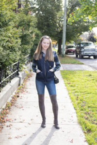 woman in vest on sidewalk