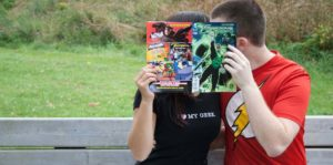 couple behind comic book