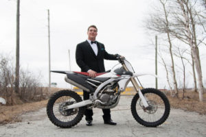 graduate with dirt bike