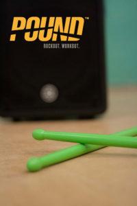speaker and drumsticks