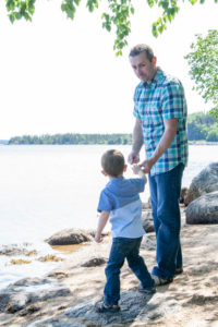 dad and son throwing rocks