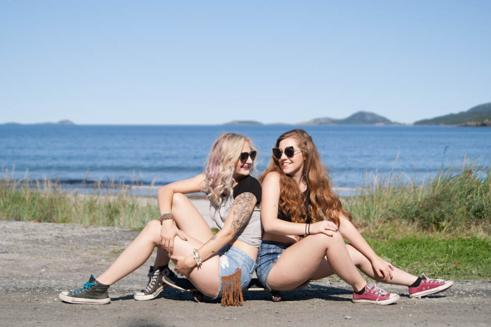 girls on a skateboard at beach