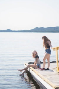 girls on a dock from distance