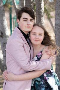 graduate and sister portrait